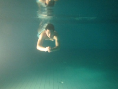 Night swimming at the pool using a Canon PowerShot D20 underwater camera.