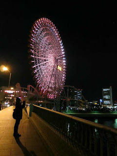 The world's largest clock in a giant ferris wheel, Cosmo Clock 21 at Yokohama.
